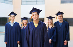 Group of smiling students in mortarboards Royalty Free Stock Image