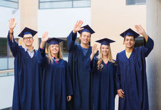 Group of smiling students in mortarboards Royalty Free Stock Images