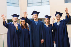 Group of smiling students in mortarboards Royalty Free Stock Photography