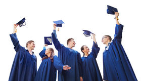 Group of smiling students with mortarboards Royalty Free Stock Photos