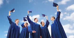 Group of smiling students with mortarboards Stock Photo