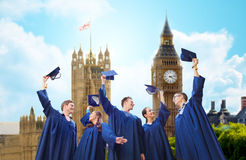 Group of smiling students with mortarboards Stock Photos