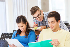 Group of smiling students with notebooks Stock Photography
