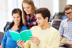 Group of smiling students with notebooks Stock Images
