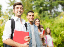 Group of smiling students outdoor Royalty Free Stock Images