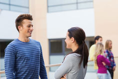 Group of smiling students outdoors Royalty Free Stock Image