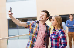 Group of smiling students outdoors Stock Photography