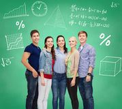 Group of smiling students over green board Stock Image