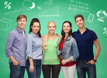 Group of smiling students over green board Royalty Free Stock Photography