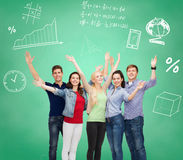 Group of smiling students over green board. Education, friendship and people concept - group of smiling students standing and waving hands over green board royalty free stock photos