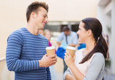 Group of smiling students with paper coffee cups Royalty Free Stock Photos