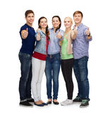 Group of smiling students showing thumbs up Stock Images