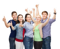 Group of smiling students showing thumbs up Royalty Free Stock Image