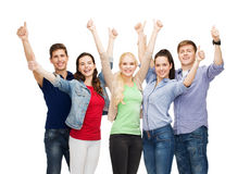 Group of smiling students showing thumbs up Stock Photos