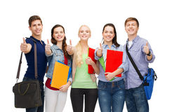 Group of smiling students showing thumbs up Stock Photo