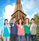 Group of smiling students showing thumbs up. Education and people concept - group of smiling students standing and showing thumbs up Royalty Free Stock Photo