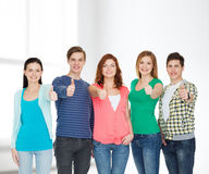 Group of smiling students showing thumbs up Royalty Free Stock Photography