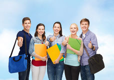 Group of smiling students showing thumbs up Royalty Free Stock Photos