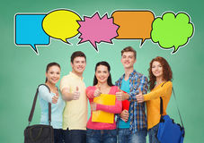 Group of smiling students showing thumbs up Stock Photography