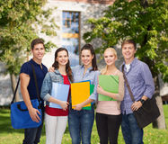 Group of smiling students standing Stock Photo