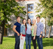 Group of smiling students standing Stock Image