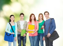 Group of smiling students standing. Education and people concept - group of smiling students standing Stock Image