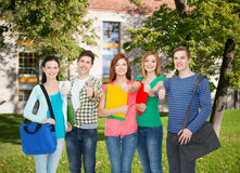 Group of smiling students standing Stock Images