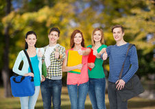Group of smiling students standing Stock Photography