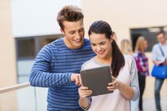 Group of smiling students tablet pc computer Royalty Free Stock Image