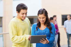 Group of smiling students tablet pc computer Stock Photography