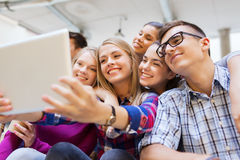 Group of smiling students with tablet pc Royalty Free Stock Image