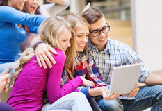 Group of smiling students with tablet pc Stock Photo