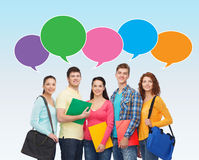 Group of smiling students with text bubbles Stock Photography