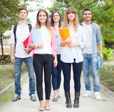 Group of smiling students walking outdoor Royalty Free Stock Photography