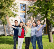 Group of smiling students waving hands Stock Photography