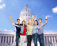 Group of smiling students waving hands Royalty Free Stock Photo