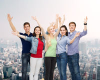 Group of smiling students waving hands Stock Photos