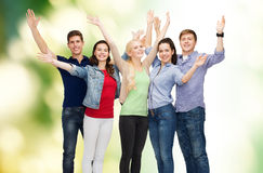 Group of smiling students waving hands Stock Images