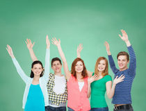 Group of smiling students waving hands Royalty Free Stock Photos