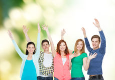 Group of smiling students waving hands Stock Image