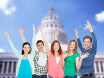 Group of smiling students waving hands Royalty Free Stock Photography