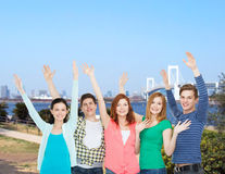 Group of smiling students waving hands Royalty Free Stock Image