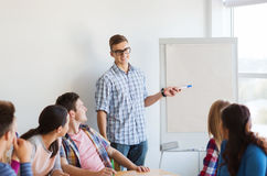 Group of smiling students with white board Royalty Free Stock Photo