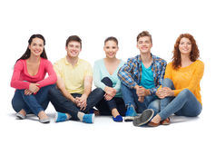 Group of smiling teenagers. Friendship, youth and people - group of smiling teenagers Stock Images