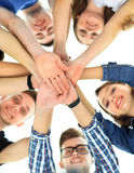 Group of smiling teenagers with hands on top of each other Royalty Free Stock Photos