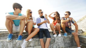 Group of smiling teenagers hanging out outdoors Stock Photos