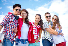 Group of smiling teenagers hanging out Royalty Free Stock Image