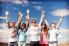 Group of smiling teenagers holding hands up Royalty Free Stock Photos
