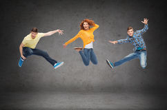 Group of smiling teenagers jumping in air Royalty Free Stock Image