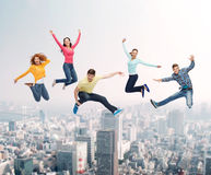 Group of smiling teenagers jumping in air Stock Images